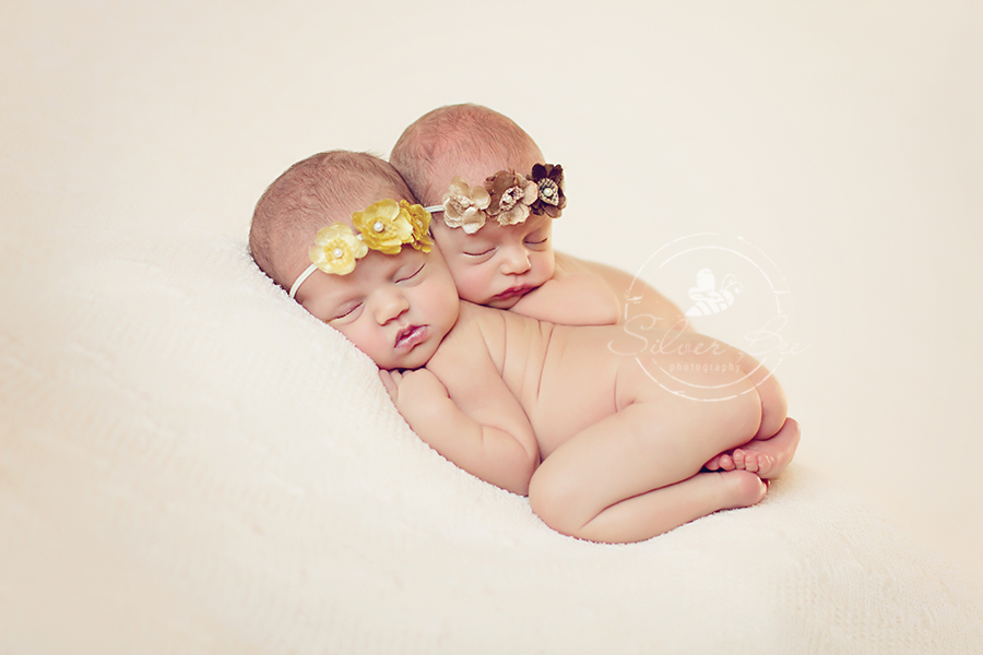 10 days old Austin twin newborn photo session with cream lace posing fabric and triple flower headbands.