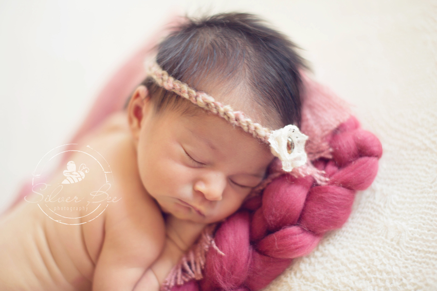 Austin Newborn Photographer with baby girl with pink headband