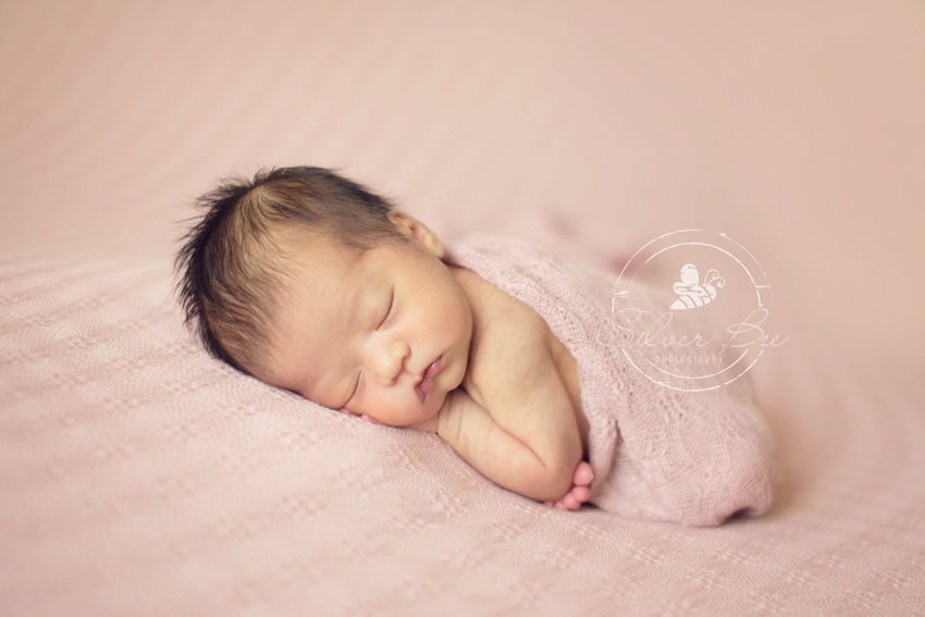 Newborn baby photographer Austin Texas with baby girl photo session at one week old.