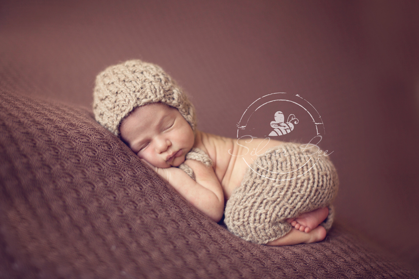 Newborn photography pants and matching bonnet from photo session in Austin Texas