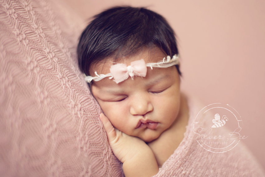 One week old newborn baby girl in Austin Texas newborn photography session