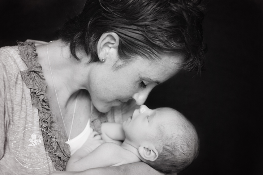 Gorgeous photo of mother and her newborn son posing for portrait session